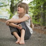 child sitting outdoors