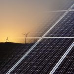 Shows renewable energy - wind turbines and solar panels